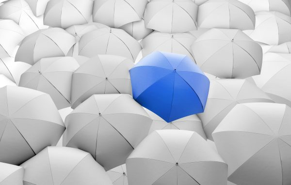 blue umbrella among white umbrellas, close up